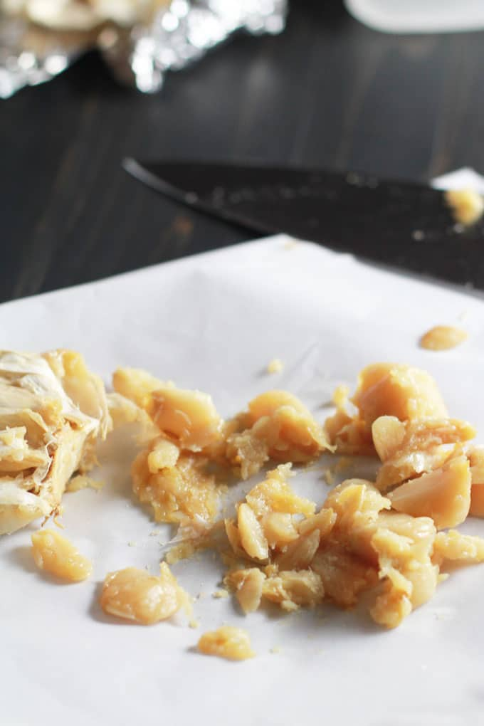 Roast garlic in bulk and freeze it for use in recipes later! | http://eatwithinyourmeans.com