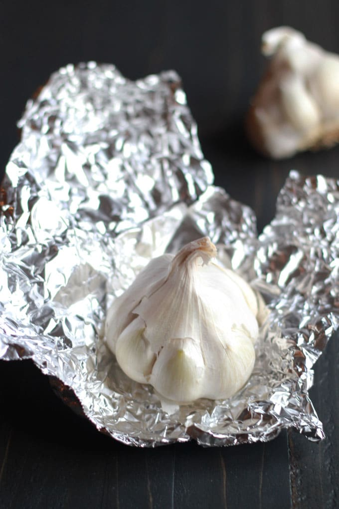 Roast garlic in bulk and freeze it for use in recipes later! | https://eatwithinyourmeans.com