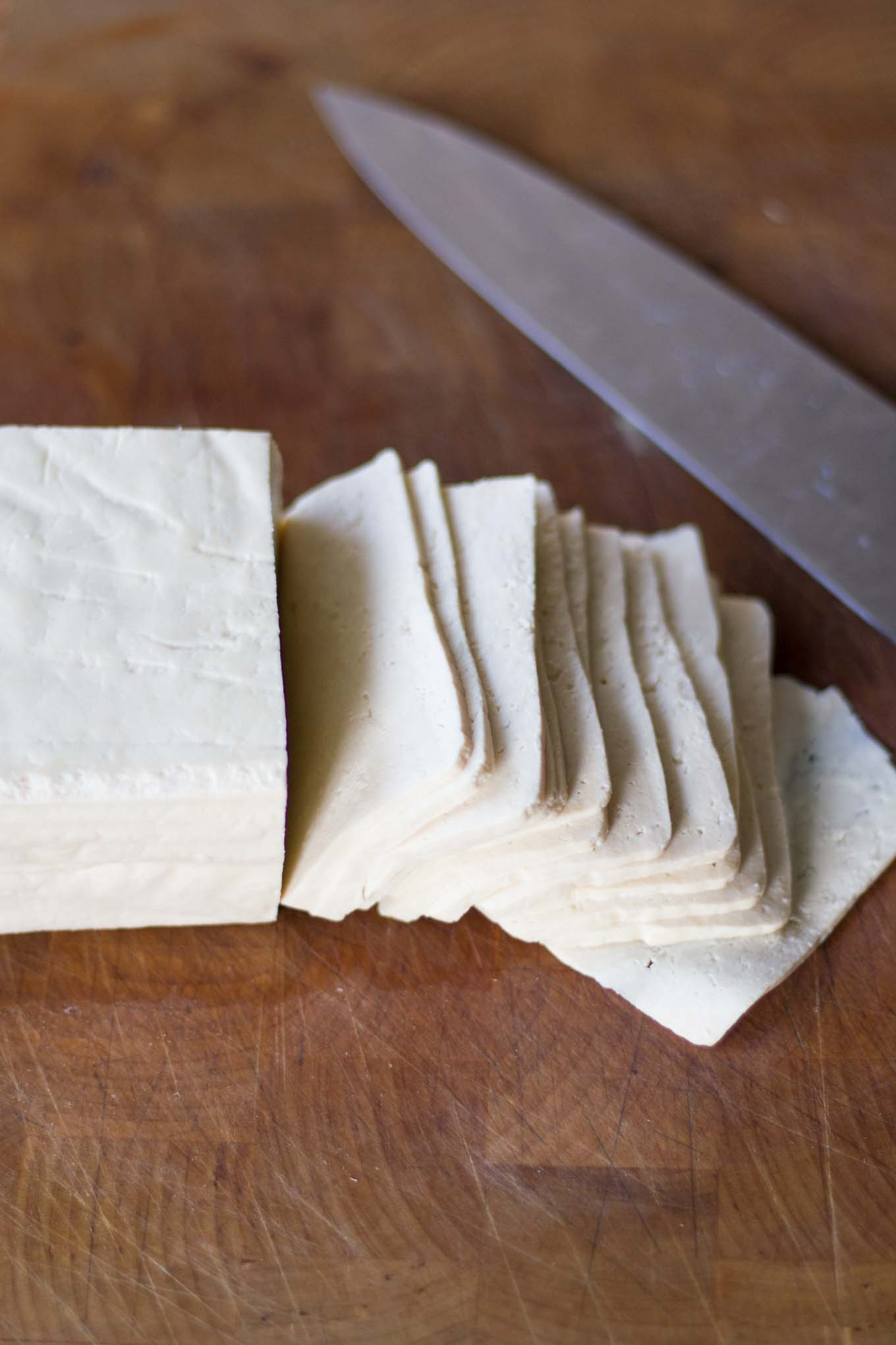 Easy Tofu Bacon - use a sharp, heavy knife to make thin slices