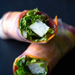 These easy vegan salad rolls (or spring rolls) are fresh and flavorful, and a feast for the eyes! Pair them with sweet potato peanut sauce for a healthy meal or snack! | https://eatwithinyourmeans.com