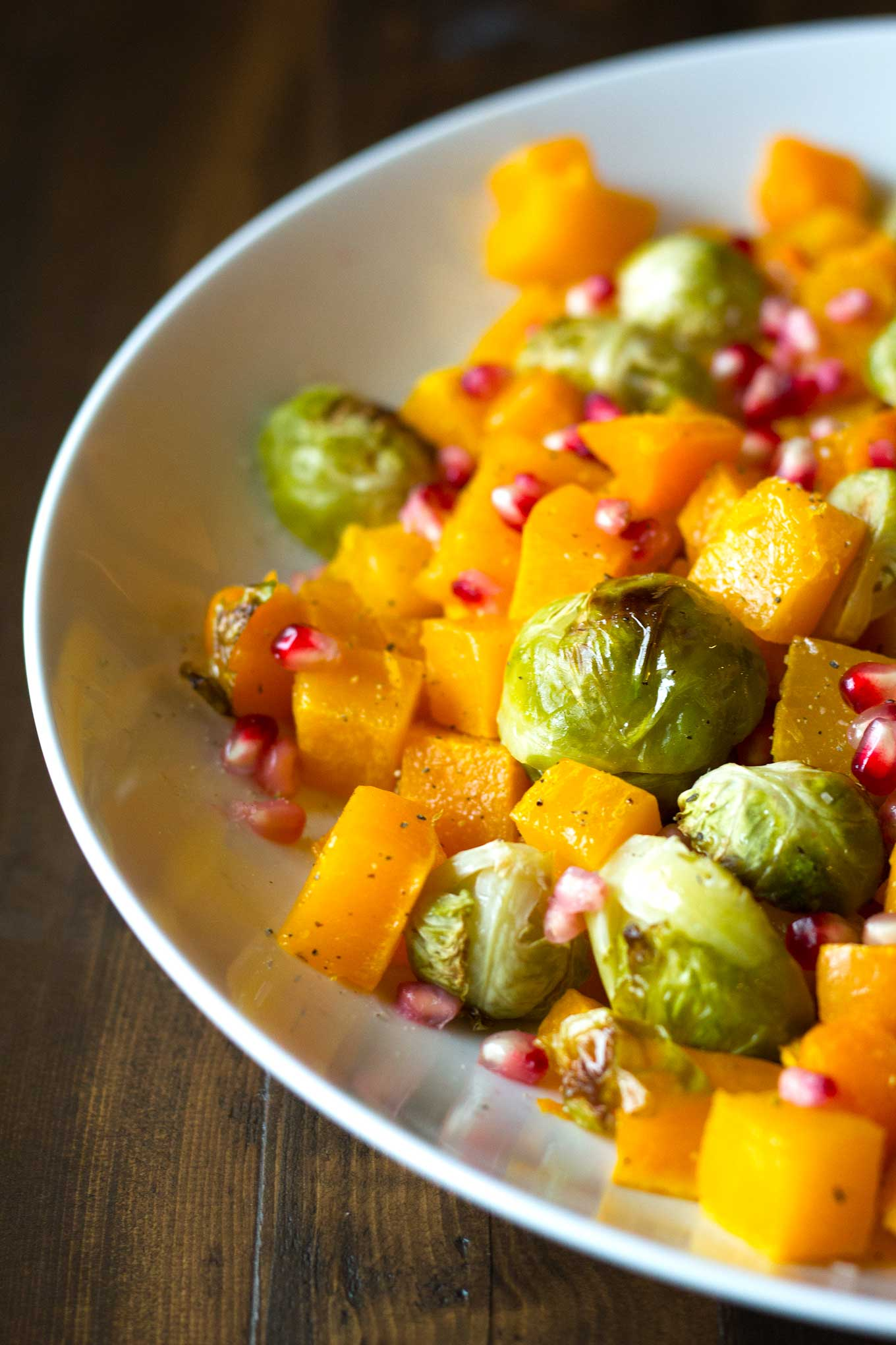 Fall Roasted Vegetables | Roasted butternut squash, brussels sprouts, sprinkled with pomegranate arils | Easy Vegan Side Dish | http://eatwithinyourmeans.com
