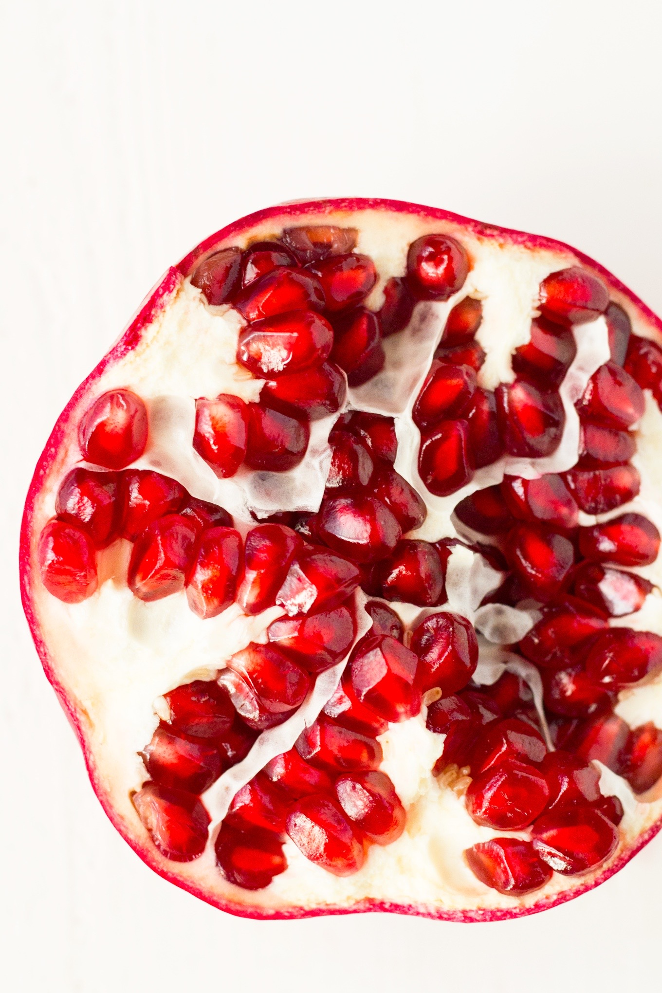 How to Seed a Pomegranate Quickly with No Mess | http://eatwithinyourmeans.com