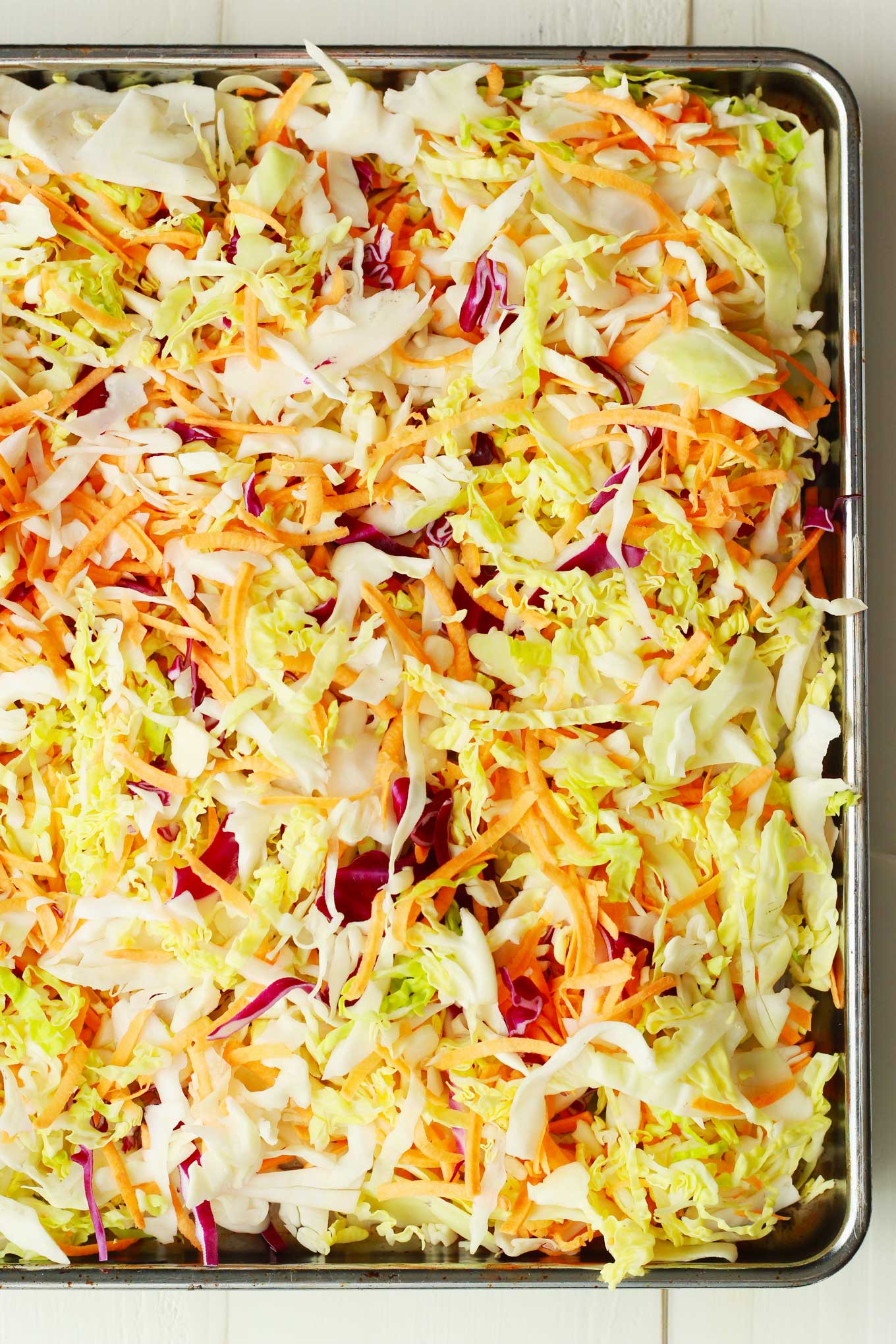 Roasted Winter Slaw | Shredded cabbage and sweet potatoes are roasted to savory side dish perfection in 20 minutes! Vegan, gluten-free, plant-based | http://eatwithinyourmeans.com
