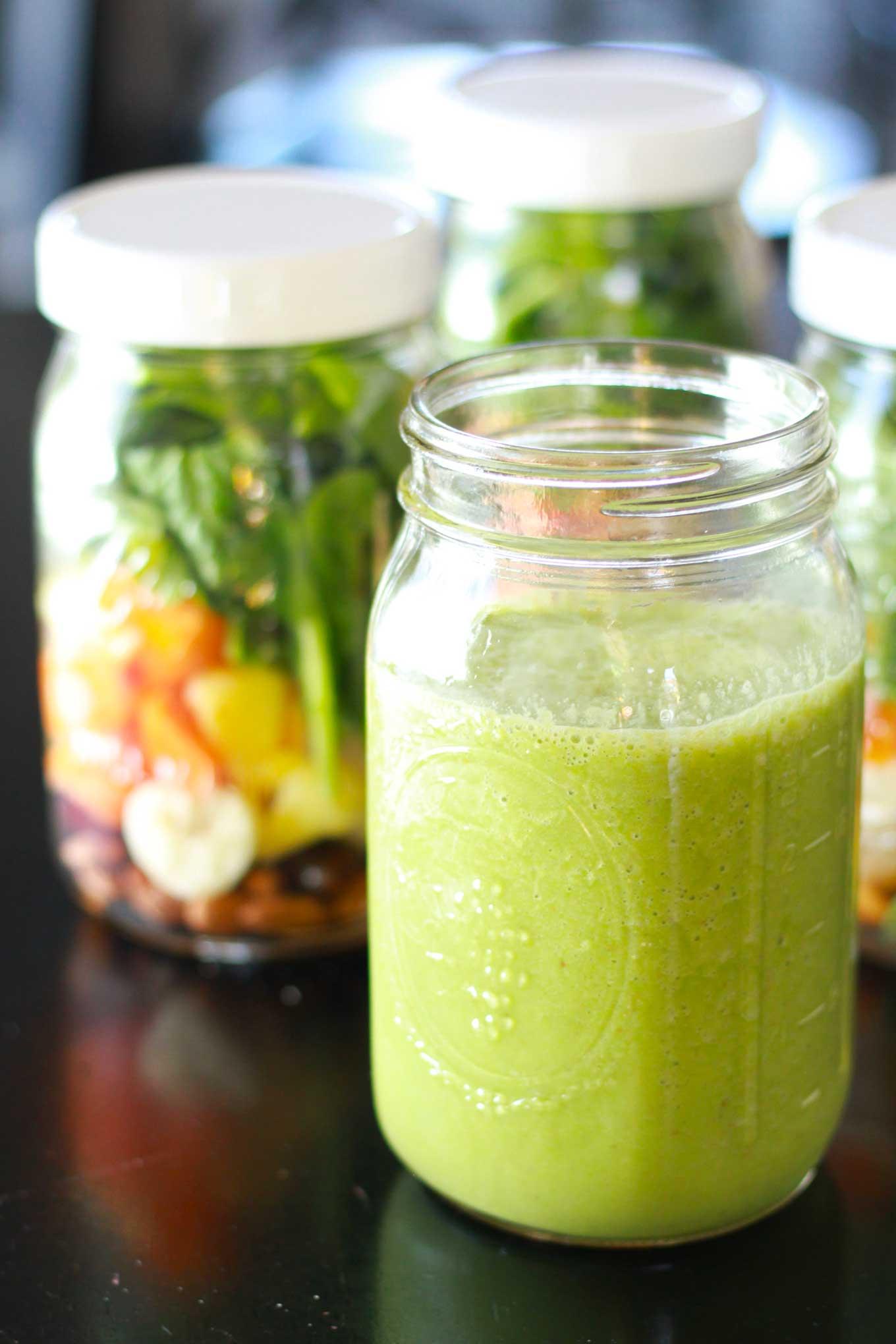 Green smoothie poured into quart size wide mouth mason jar | Vegan green smoothie recipe | https://passtheplants.com/
