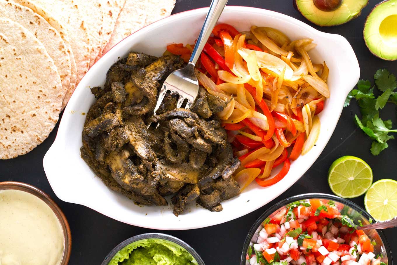 Ultimate Vegan Fajitas | Marinated portobello mushrooms, peppers, onions, pico de gallo, guacamole, cashew cream, tortillas | https://passtheplants.com/