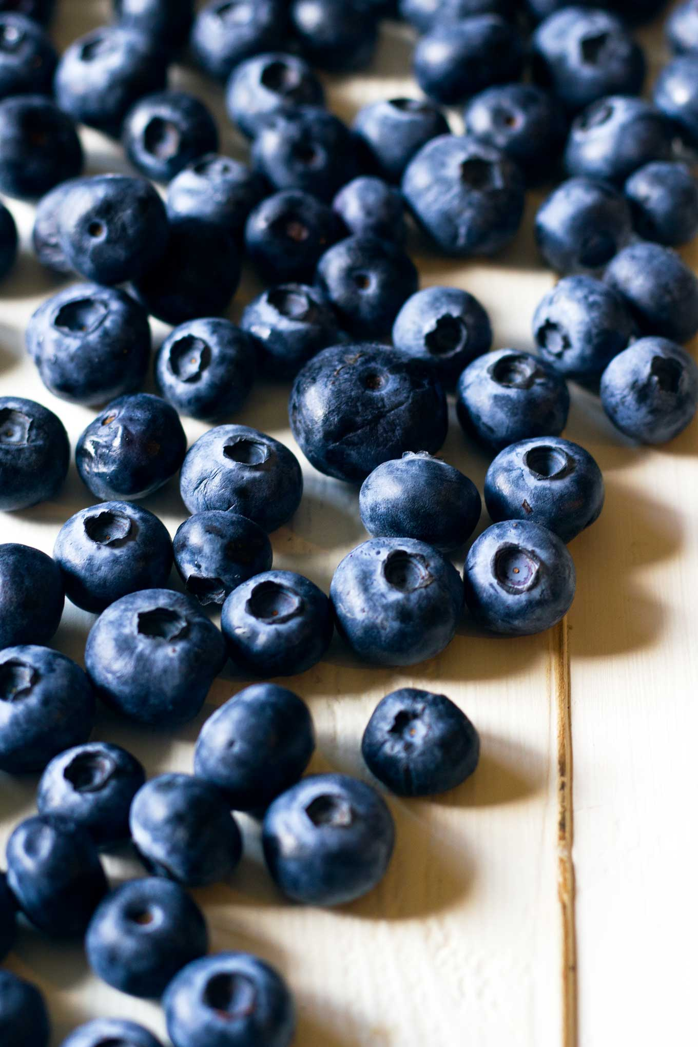 Dairy-Free Patriotic Popsicles | Close-up of fresh blueberries | Vegan, dairy-free, naturally sweetened, fruit dessert, 4th of July, Memorial Day, popsicle | https://passtheplants.com/