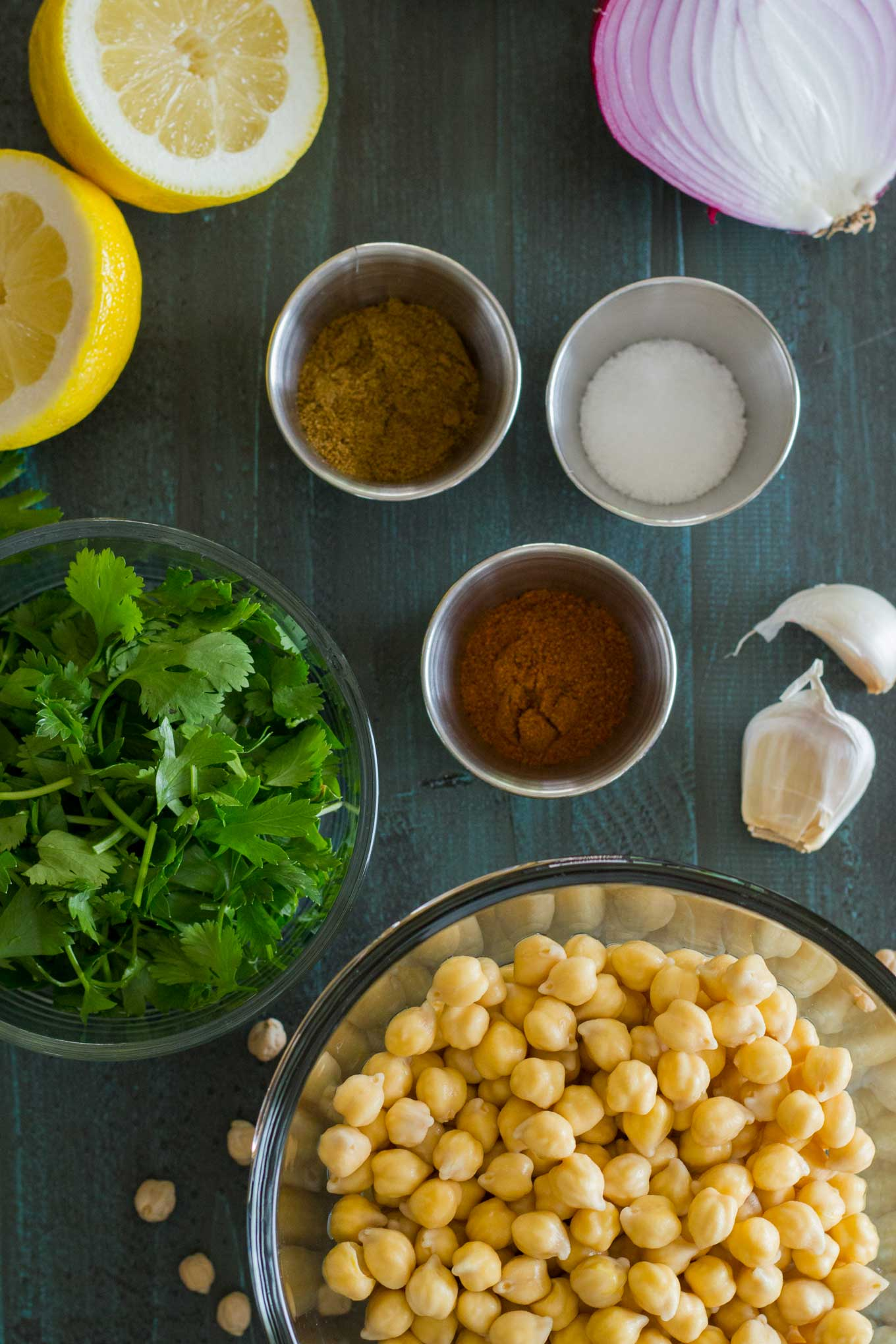 Oven-Baked Falafel ingredients are soaked chickpeas, lemon, parsley, ground cumin, cayenne powder, salt, fresh lemon, and red onion | Plant-based | Oil-free | Vegan | Gluten-free | https://eatwithinyourmeans.com/