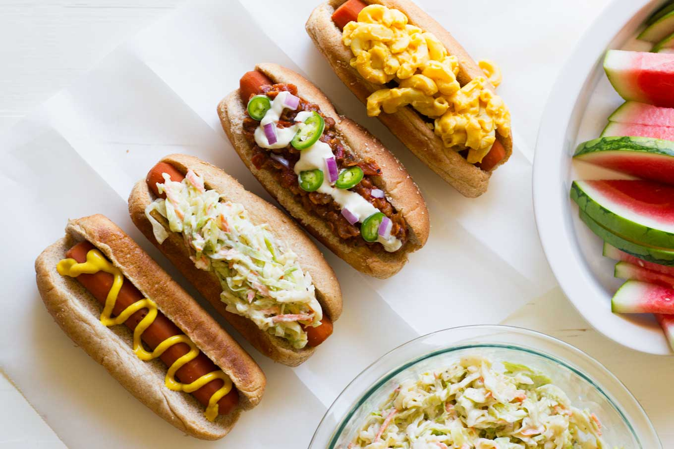 Carrot dogs topped with mustard, coleslaw, vegan chili, and vegan mac and cheese | Easy Carrot Dogs | Plant-based | Vegan | Recipe | https://passtheplants.com/