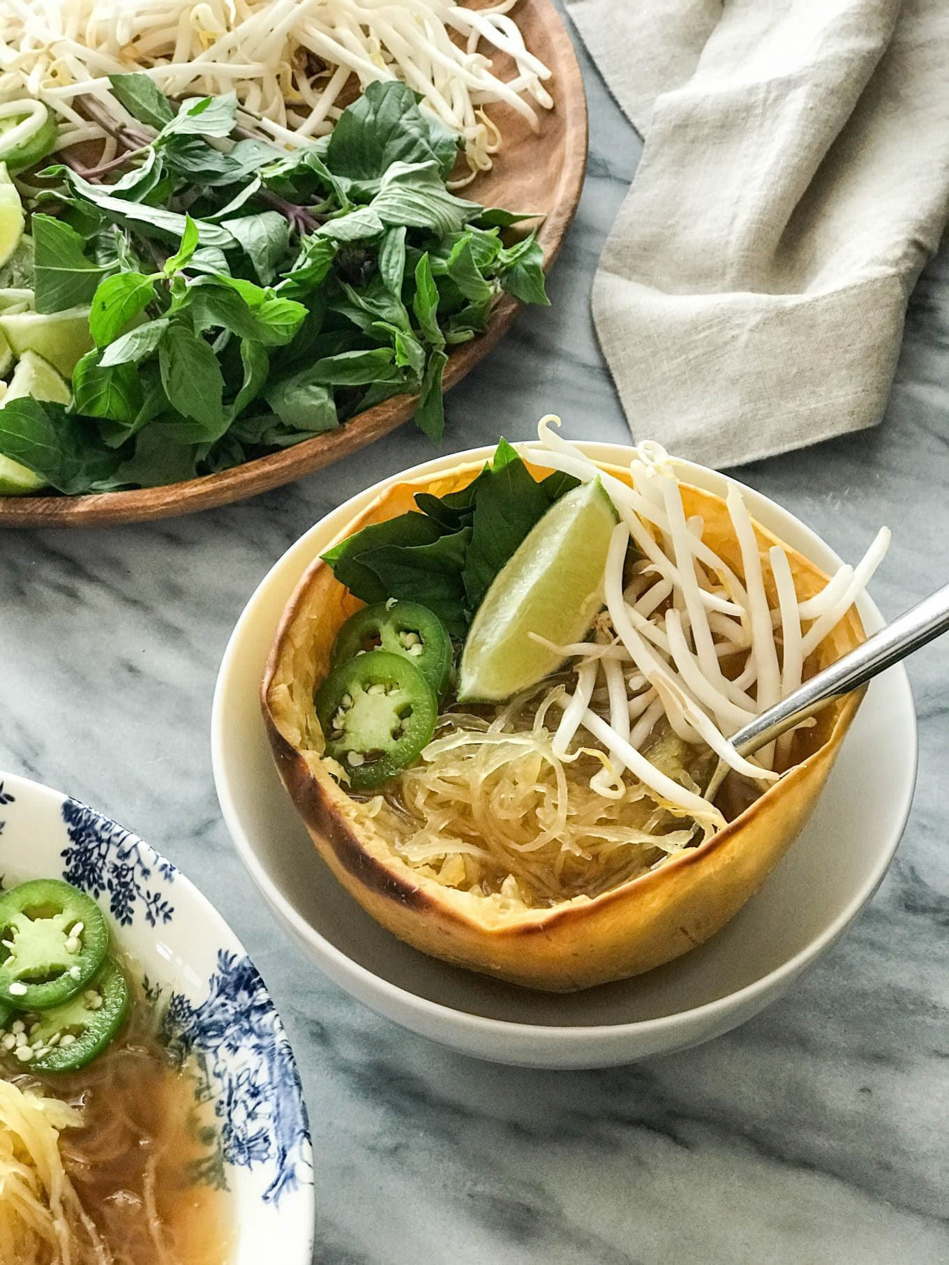 Spaghetti Squash Vegan Pho | Spaghetti squash half used as bowl | https://eatwithinyourmeans.com/