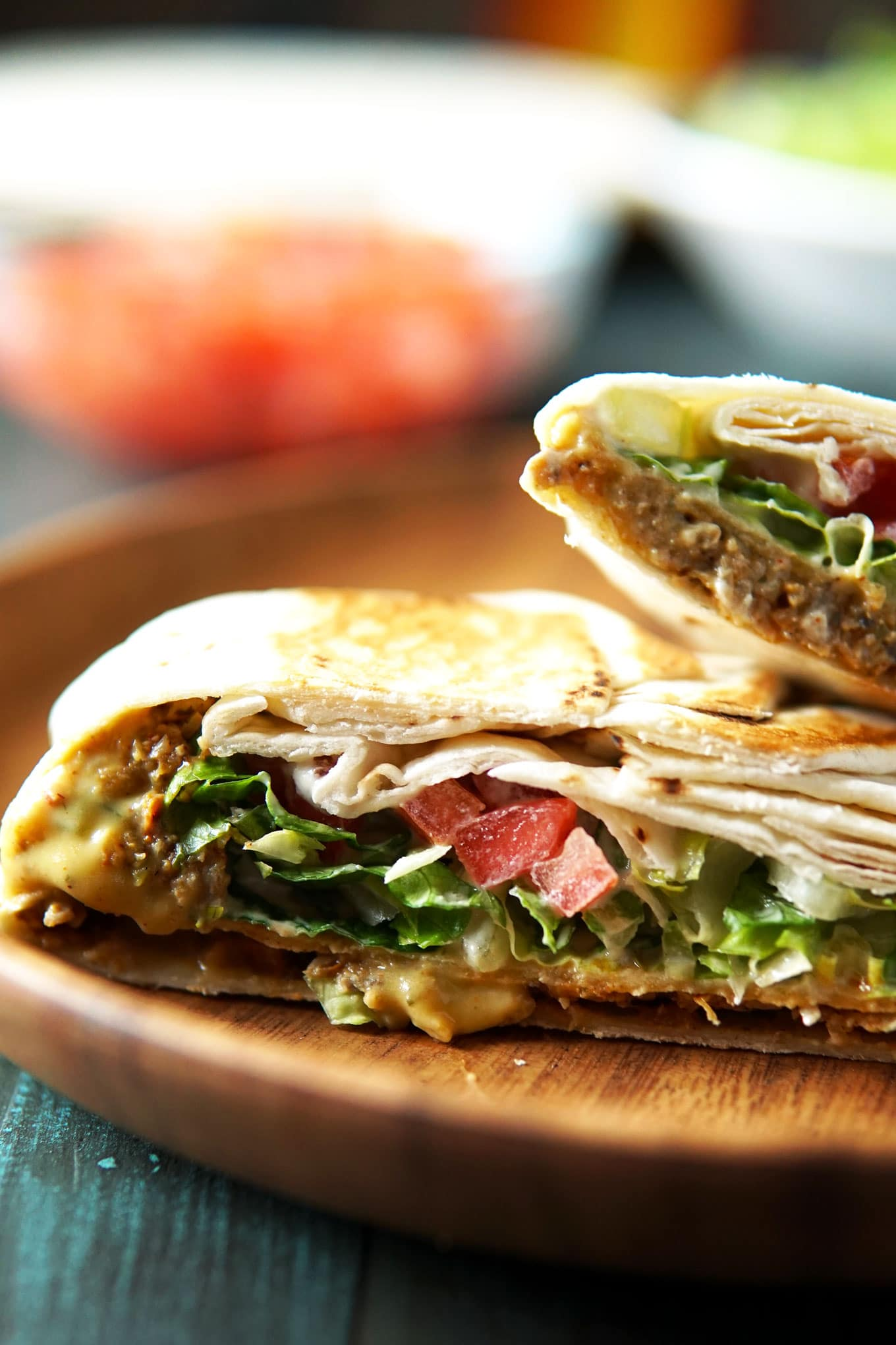 Close-up of vegan crunch wrapsupreme cut in half on a plate