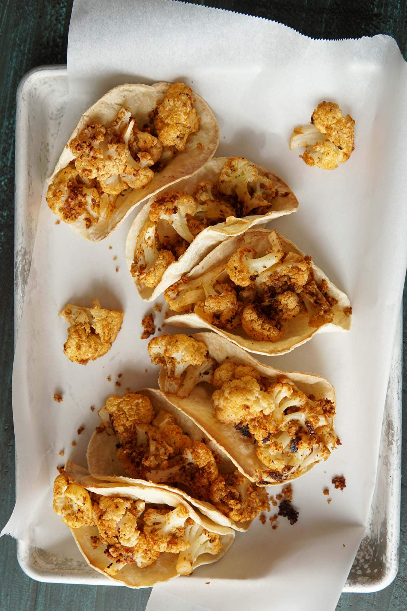 Chipotle Cauliflower Tacos without toppings on baking sheet