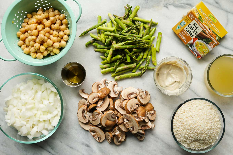 Overheat shot of ingredients for Instant Pot Vegan Risotto | Chickpeas, onion, olive oil, asparagus, mushrooms, cashew cream, arborio rice, vegetable broth