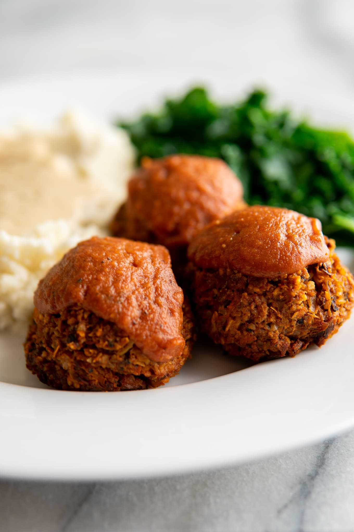 Close-up of vegan meatball cups on plate.